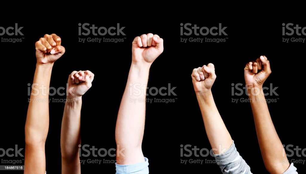 Five mixed air-punching fists against black stock photo