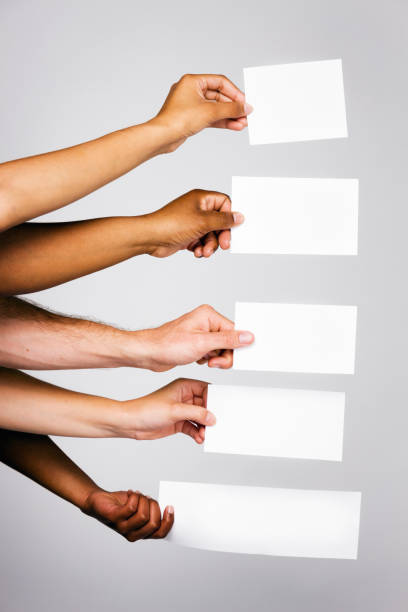 Five mixed hands holding blank signs stock photo