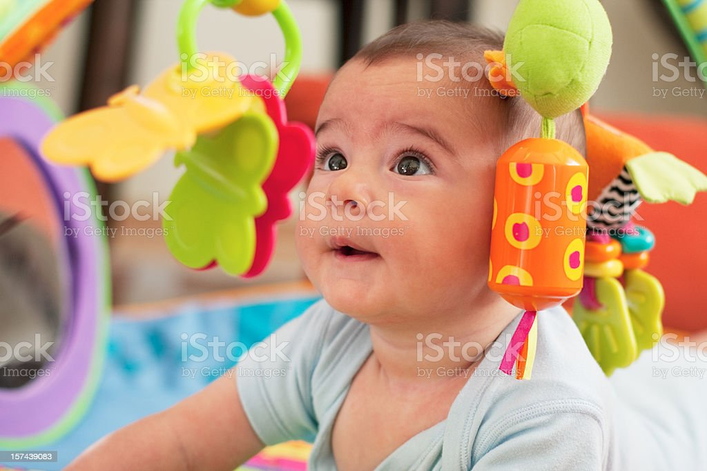 Five months old baby girl is playing stock photo