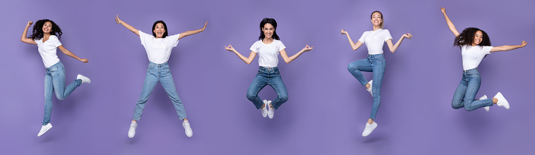Five Multiracial Women Jumping Posing In Mid-Air Over Purple Background