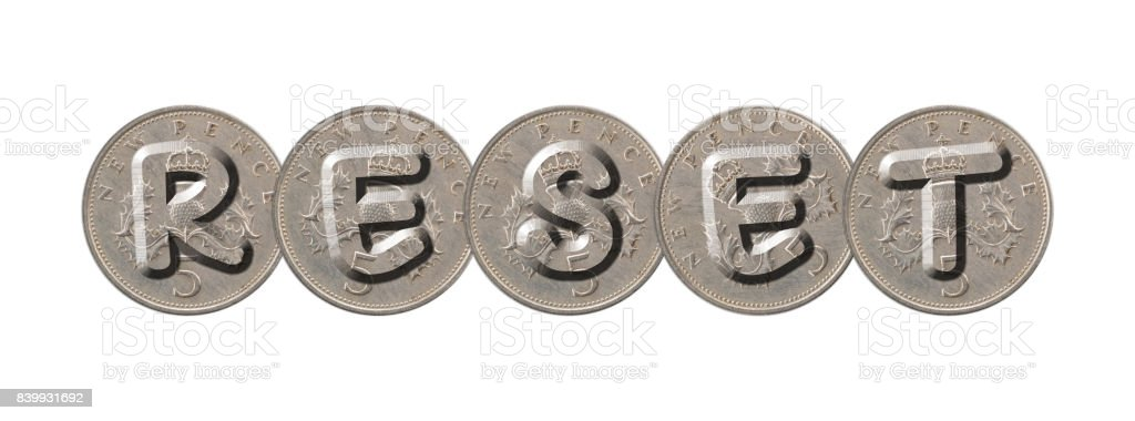RESET – Five new pence coins on white background stock photo