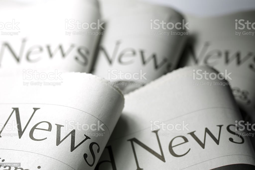 Five newspapers stacked and folded together stock photo