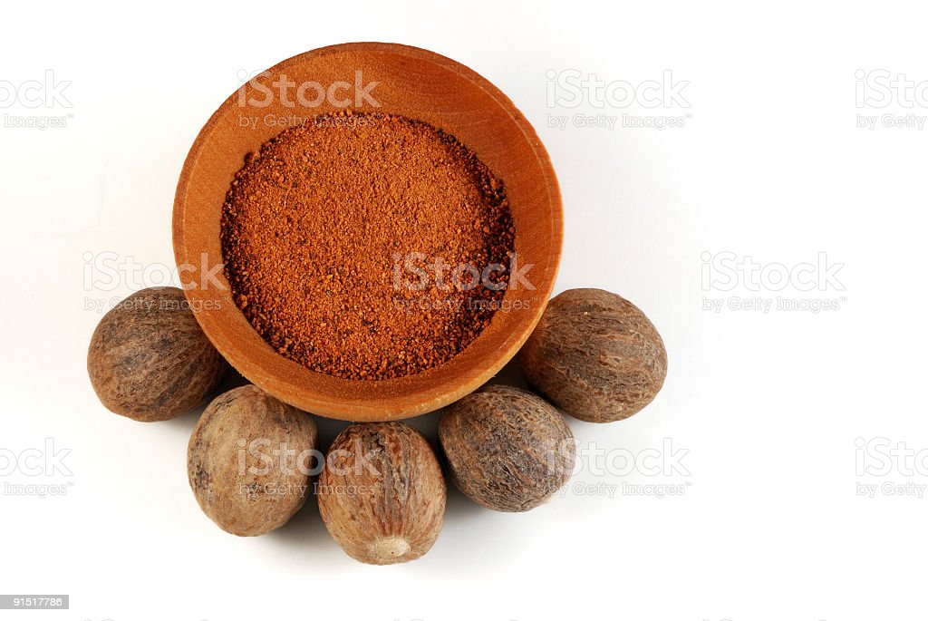 Five Nutmeg nuts and powder royalty-free stock photo