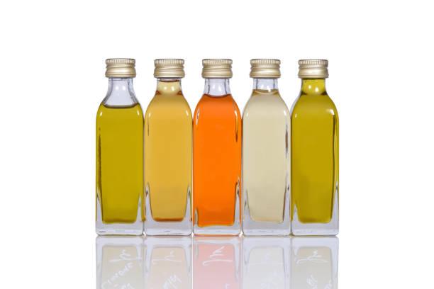 five oil bottles stock photo