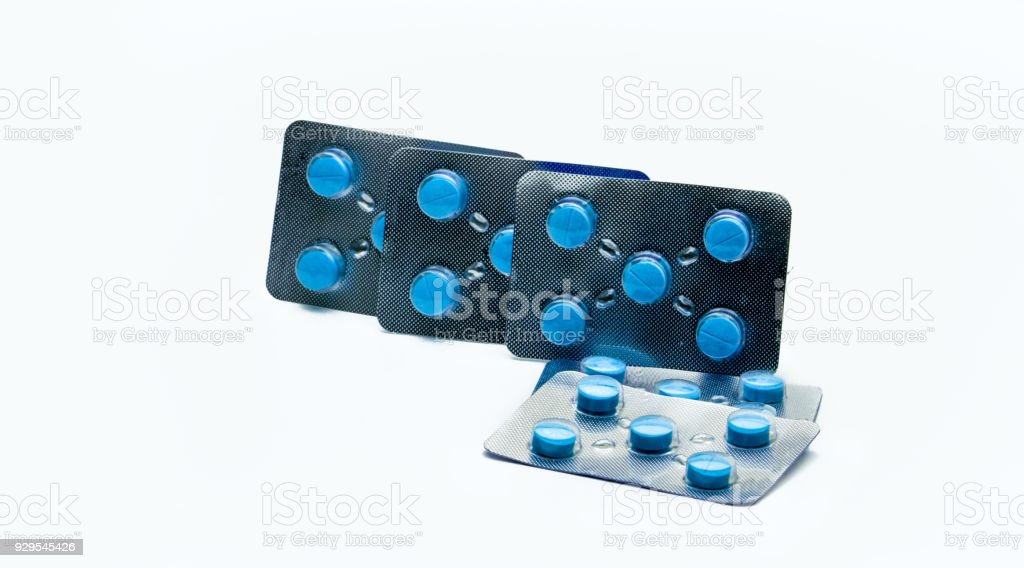 Five pack of acyclovir tablet pills for full course treatment of herpes on the genitals or mouth. Antiviral medicine for herpes simplex virus (HSV) or herpes zoster. Sexual transmitted disease concept stock photo