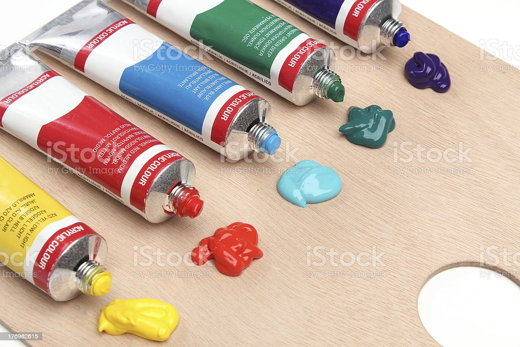 Five paint tubes over a pallete royalty-free stock photo