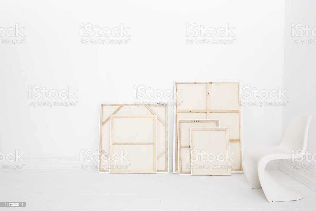 Five paintings with chair on left royalty-free stock photo