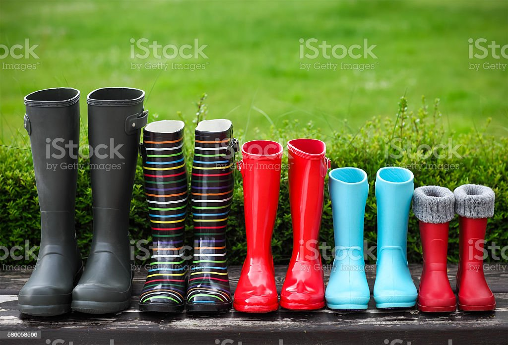 Five pairs of a colorful rain boots stock photo