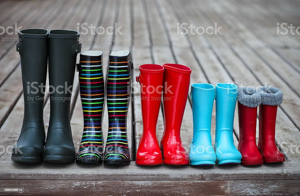 Five pairs of a colorful rain boots royalty-free stock photo
