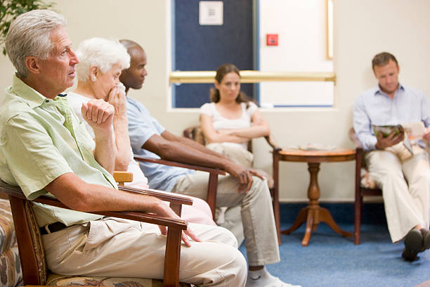 Five people in waiting room stock photo
