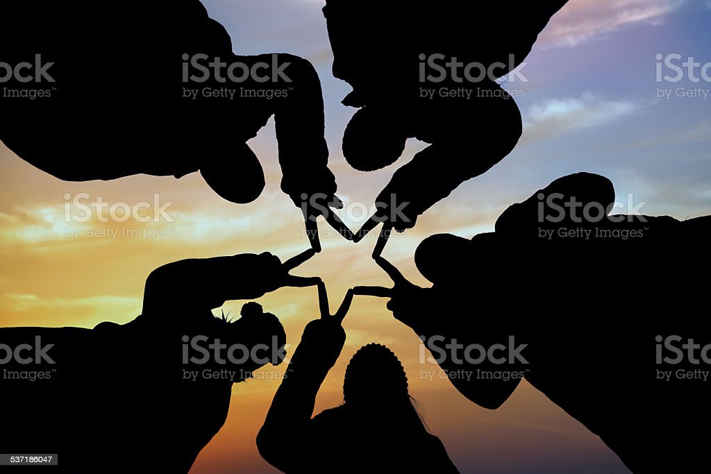 Five people who put their hands on top of stock photo