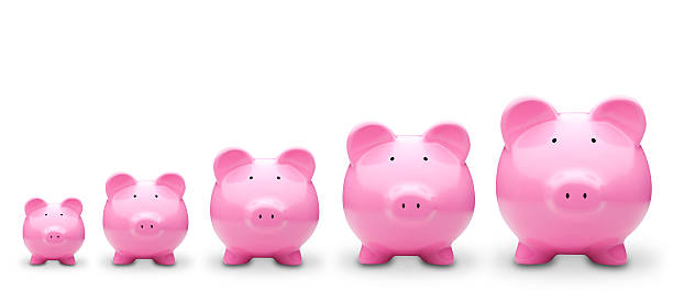 Five Piggy Banks in a row stock photo
