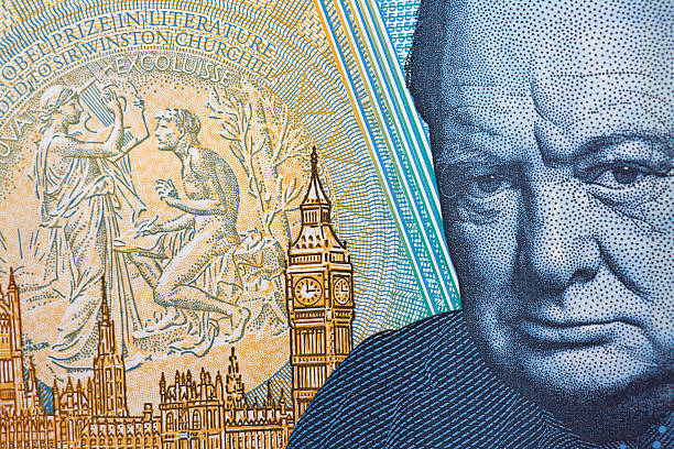 Five Pound Note Close up of the new water proof polymer five pound note, showing the head of Sir Winston Churchill on the reverse side. british currency stock pictures, royalty-free photos & images