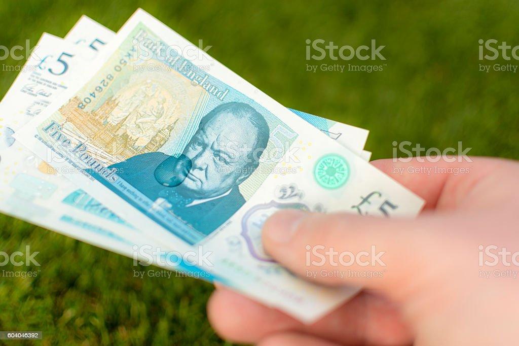 UK Five Pound Note - Waterproof Bundle 2016 stock photo
