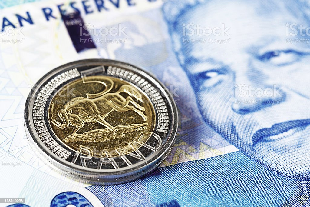 Five Rand coin rests on new Mandela South African banknote stock photo