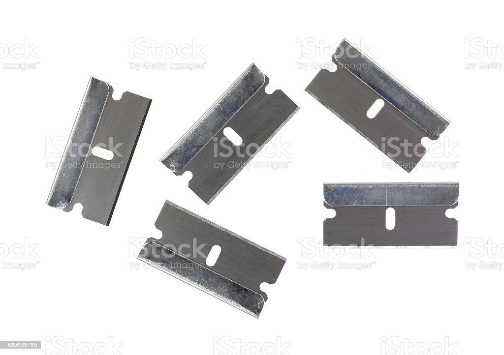 Five razor blades on white background stock photo