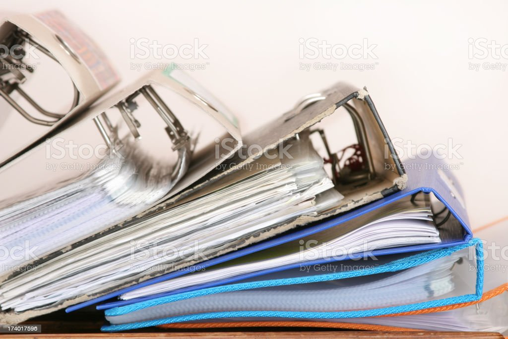 Five ring binder folders on top of one another royalty-free stock photo