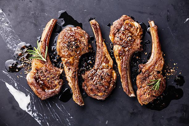 Five roaster lamb ribs with herbs stock photo