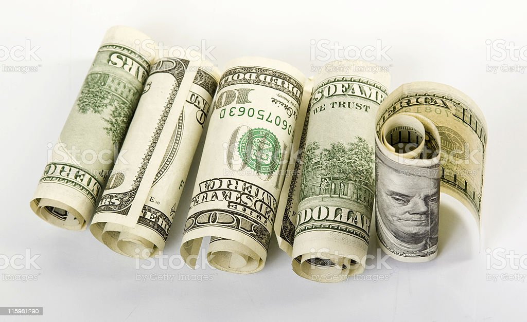 five rolled $100 bills; for laying down and one standing up royalty-free stock photo