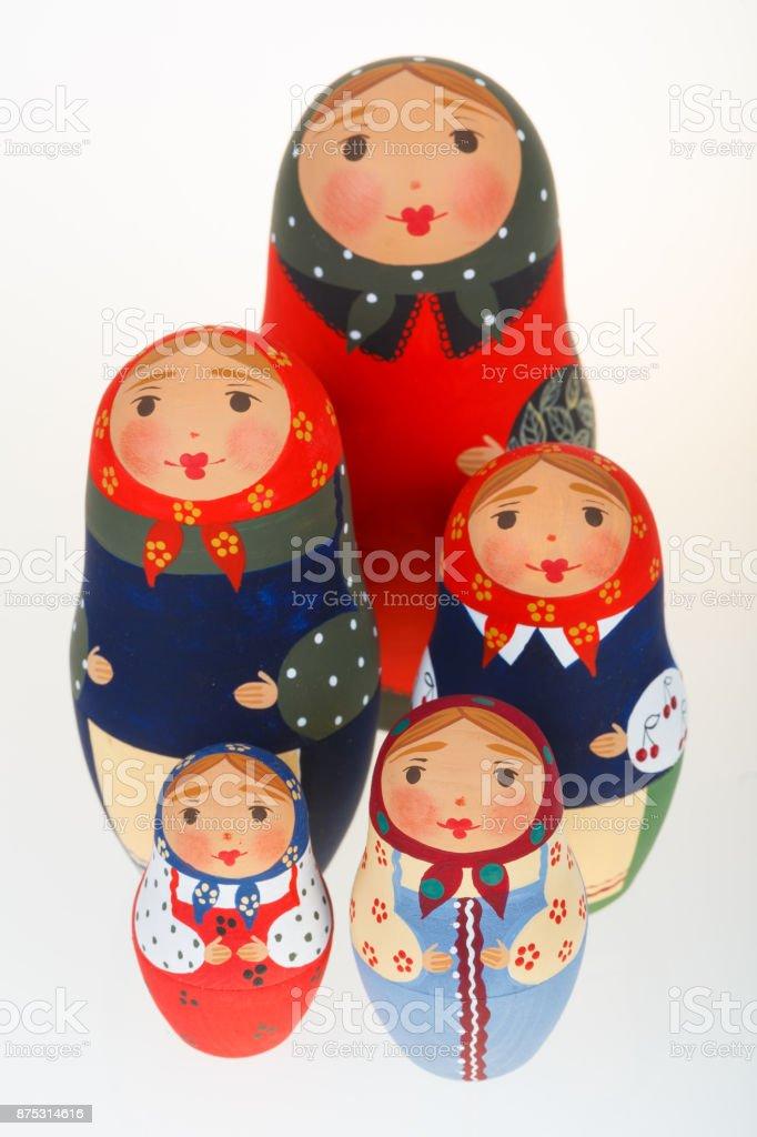 Five Russian dolls babushka matryoshka isolated on white stock photo