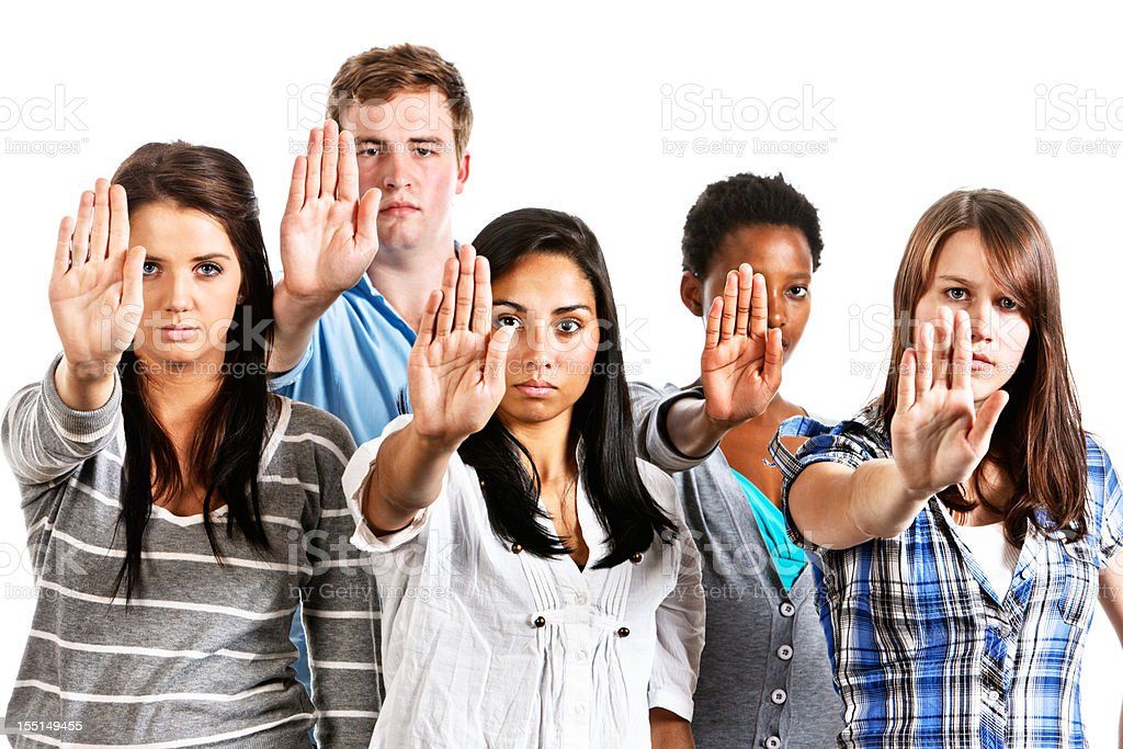 Five serious young people making Stop gesture royalty-free stock photo