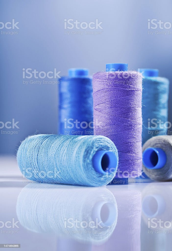five sewing spools stock photo
