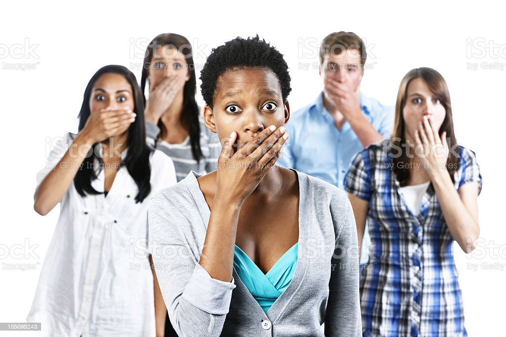 Five shocked young people with hands over their mouths stock photo