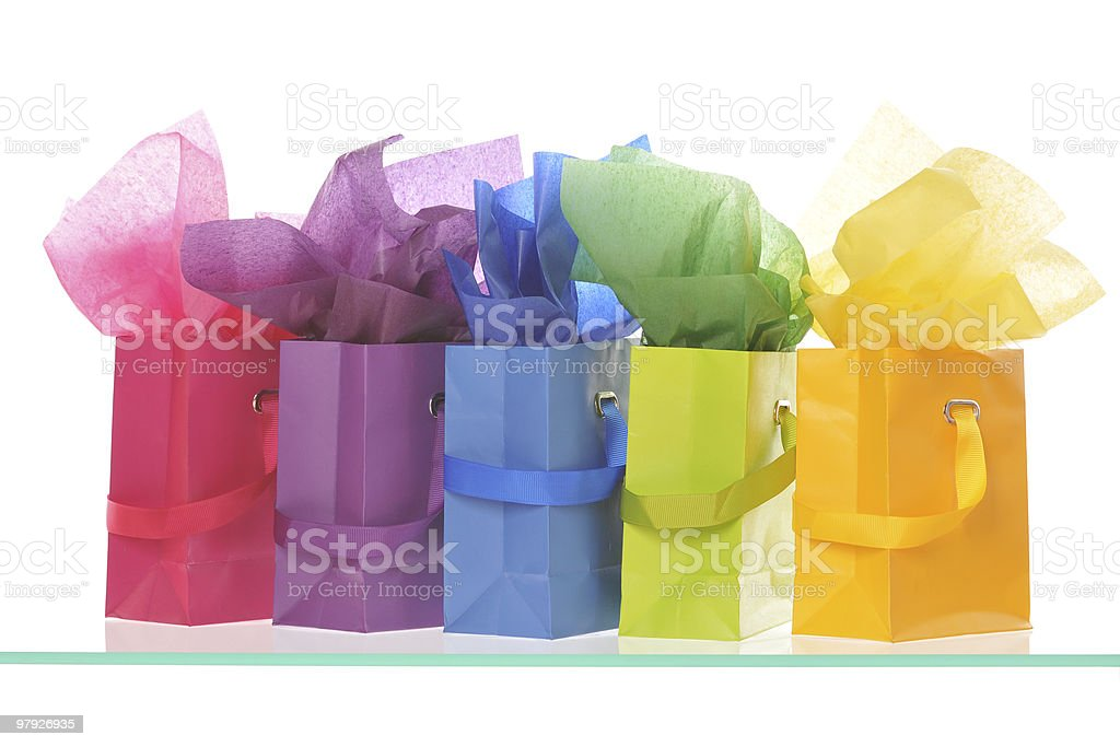 Five shopping bags in a row royalty-free stock photo
