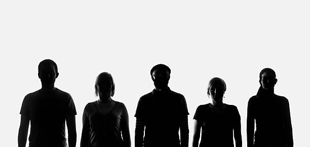 Five silhouettes of people stock photo
