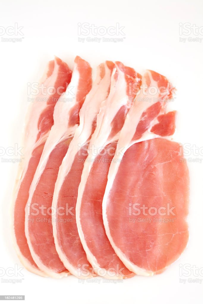Five slices of uncooked bacon on white background stock photo