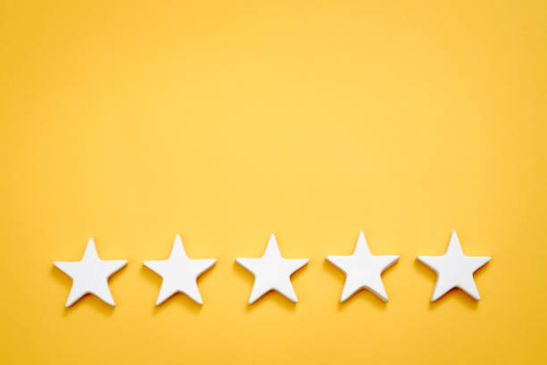 five star quality rating evaluation classification Top quality rating. Evaluation and classification. Five white stars on yellow background. Copy space. adulation stock pictures, royalty-free photos & images