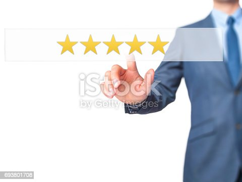 istock Five star rating - Businessman hand pressing button on touch screen interface. 693801708