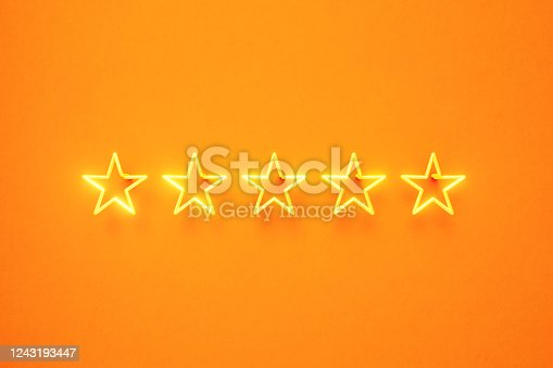 istock Five Star Written by Yellow Neon Light on Yellow Background 1243193447