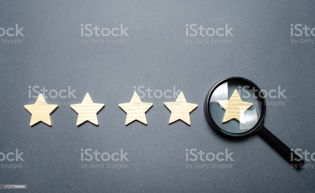Five stars and a magnifying glass on the last star. Check the...
