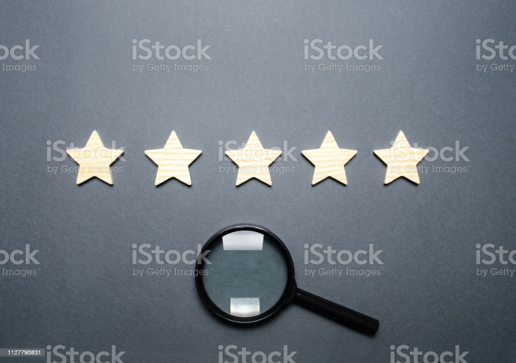 Five stars and a magnifying glass. Rating of hotels and restaurants,...