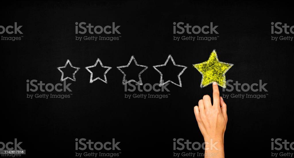 Five stars concept on blackboard
