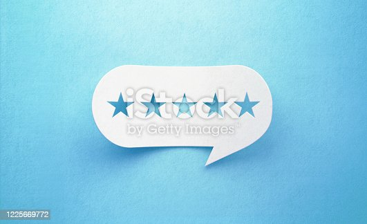 Five stars drawn white chat bubble on blue background. Horizontal composition with copy space. Rating and survey concept.
