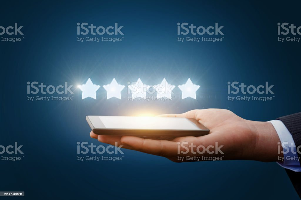 Five stars from a tablet. stock photo