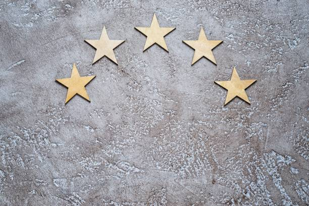 Five stars in half round on cement background, top view with copy space. stock photo