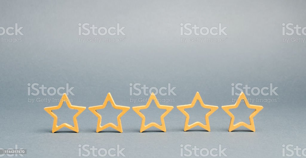 Five stars on a gray background. The concept of the best housing,...