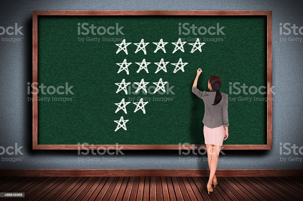 Five Stars on chalkboard stock photo