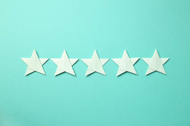 Five stars quality rating on mint green background stock photo