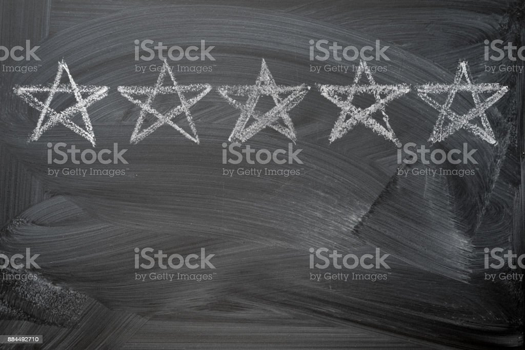 five stars rating on chalkboard stock photo