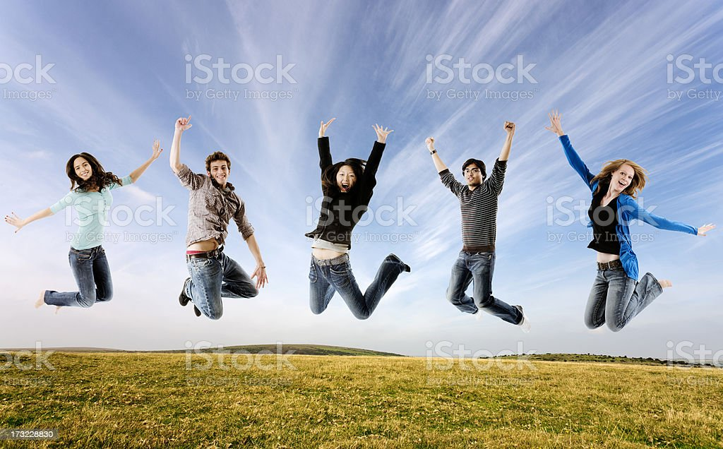 Five students jumping, outdoors royalty-free stock photo