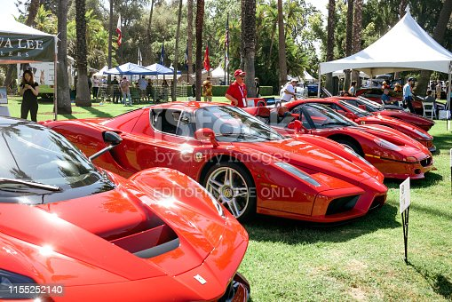 San Marino, California/USA - June 9, 2019: A line of red Ferrari cars are displayed in Lacy Park for the 9th Annual San Marino Motor Classic
