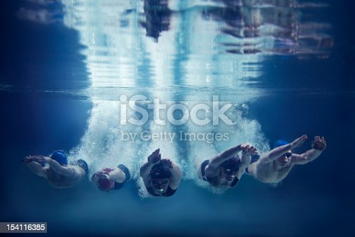 istock Five swimmers jumping together into water- underwater 154116385