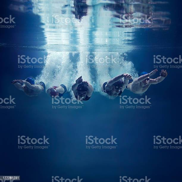 Five swimmers jumping together into water underwater view picture id177281231?b=1&k=6&m=177281231&s=612x612&h=yfsngchrdflaizvyecpntukw1oeluqreuhjbmpvu6aw=