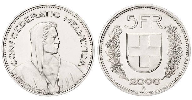 five swiss franc on white background - franken stockfoto's en -beelden