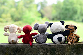 ,five tales ,friends forever ,the back of five dolls sitting on wall