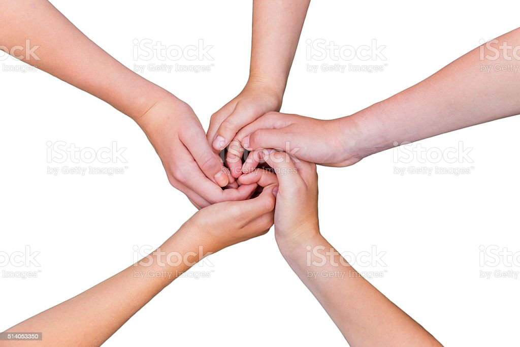 Five teenage arms with hands entangled isolated on white backgro stock photo